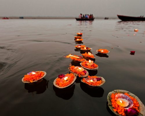 Candles floating in the Ganges River, Varanasi, India
